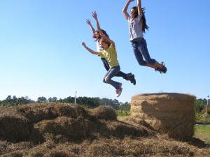 Fun at the farm in the hay